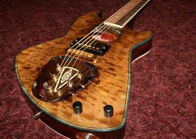 cool custom dark wood electric guitar with backwards headstock for sale