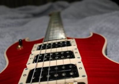 cool custom flame red electric bass guitar with three humbuckers for sale