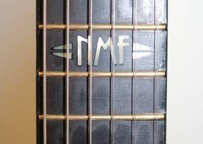 cool custom dark ocean blue electric bass guitar custom inlays on fretboard
