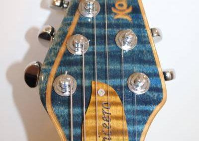 cool custom stripe blue electric bass guitar headstock