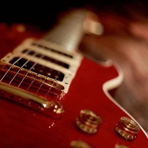 custom red wood electric guitar hardware and custom options
